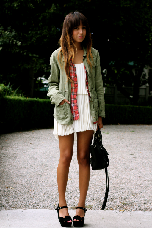 Check layered underneath a military jacket