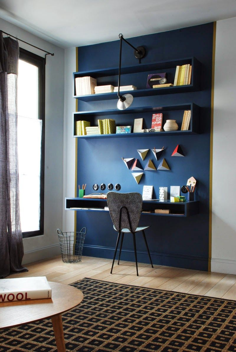 Nice idea to paint the shelves and desk the same color as the wall ...