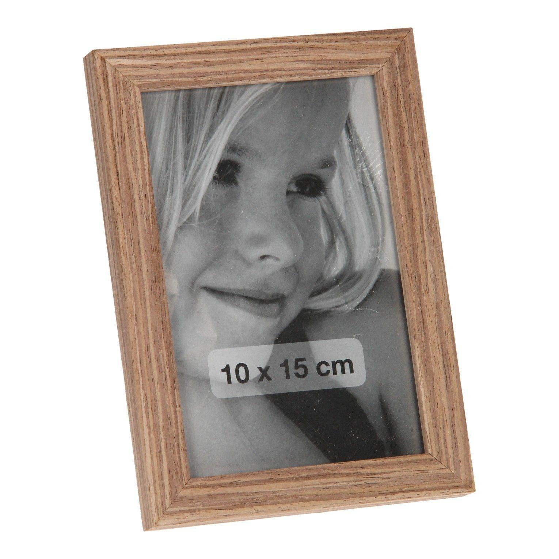 Bewaar je mooiste momenten in dit bruine houten fotolijstje. De fotolijst is 17 cm groot en geschikt voor een foto van 10 x 15 cm.Afmeting: 17 x 12 cm - Fotolijst Blank Bruin, 17cm