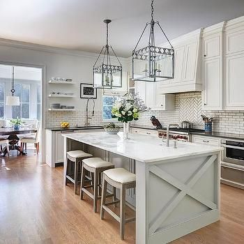 White Kitchen With Gray Center Island And Backless Wood Stools