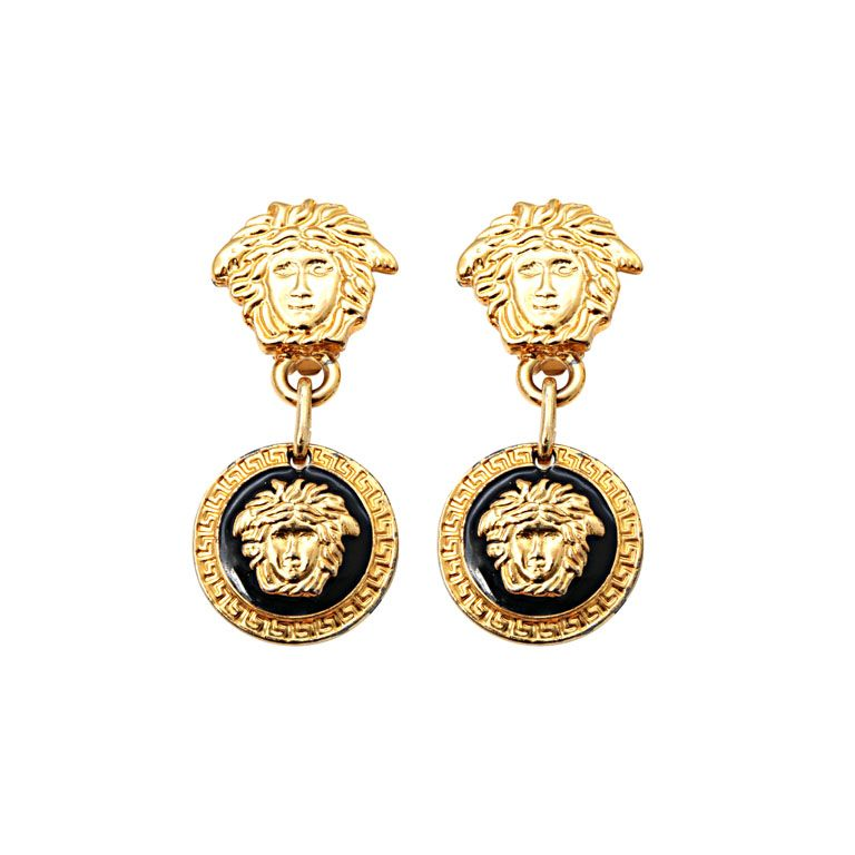 5cce1d48ccb2 I m totally itching for these vintage Gianni Versace Medusa Earrings.