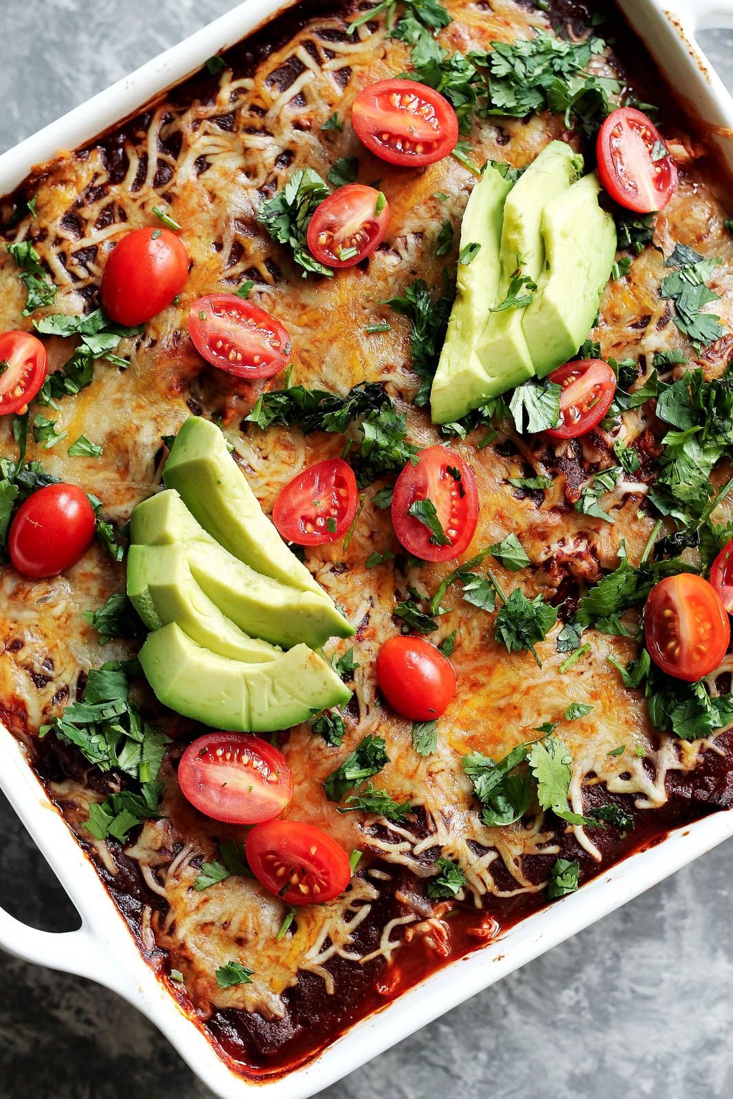 Low carb chicken zucchini enchilada bake with layers upon layers of creamy flavorful goodness Refried beans cheese chicken zucchini and a homemade enchilada sauce