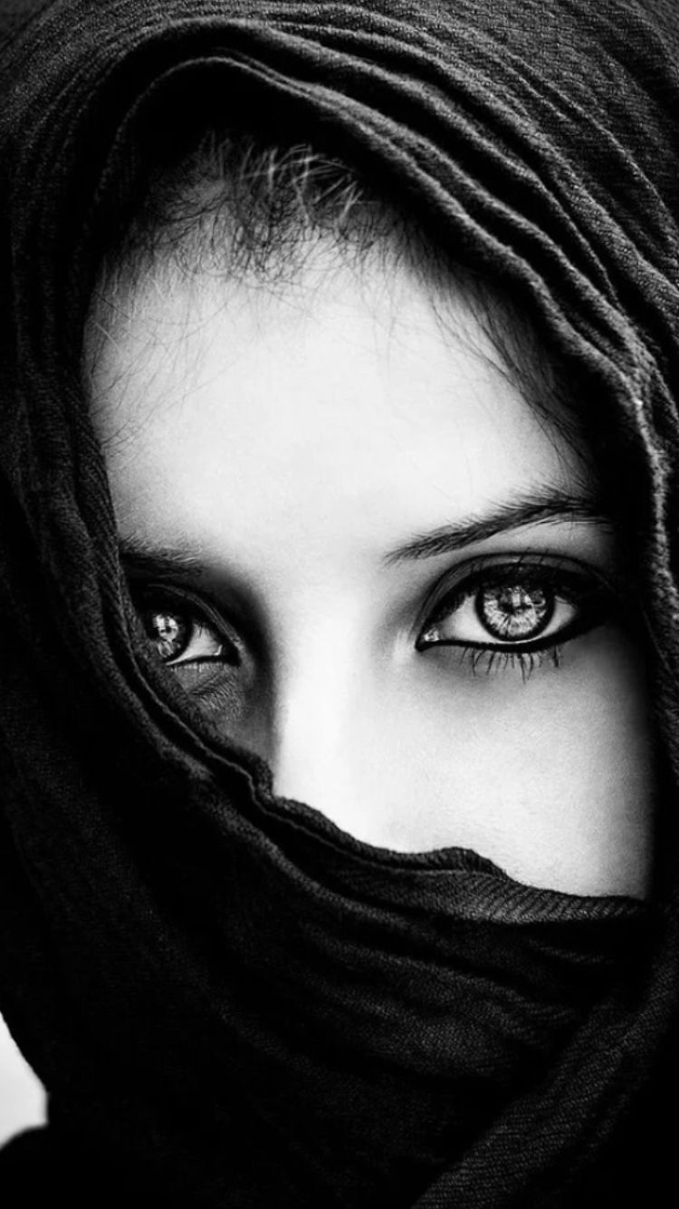 Her head was covered with black cloth leaving only her dark intense eyes staring at me