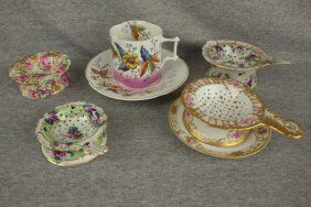 Porcelain lot of 4 tea strainers & one cup/saucer