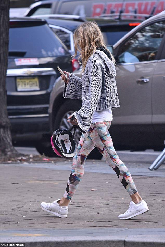 e2a70cb30dda Chic  Sienna cut a casual figure in graphic print leggings and white Reebok  trainers