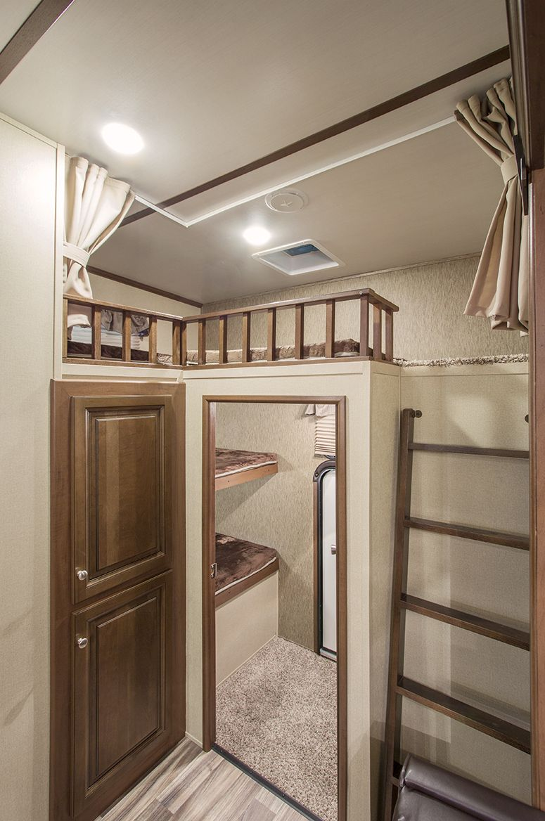 Below the loft is a private sunken bedroom with two more for Rv with loft