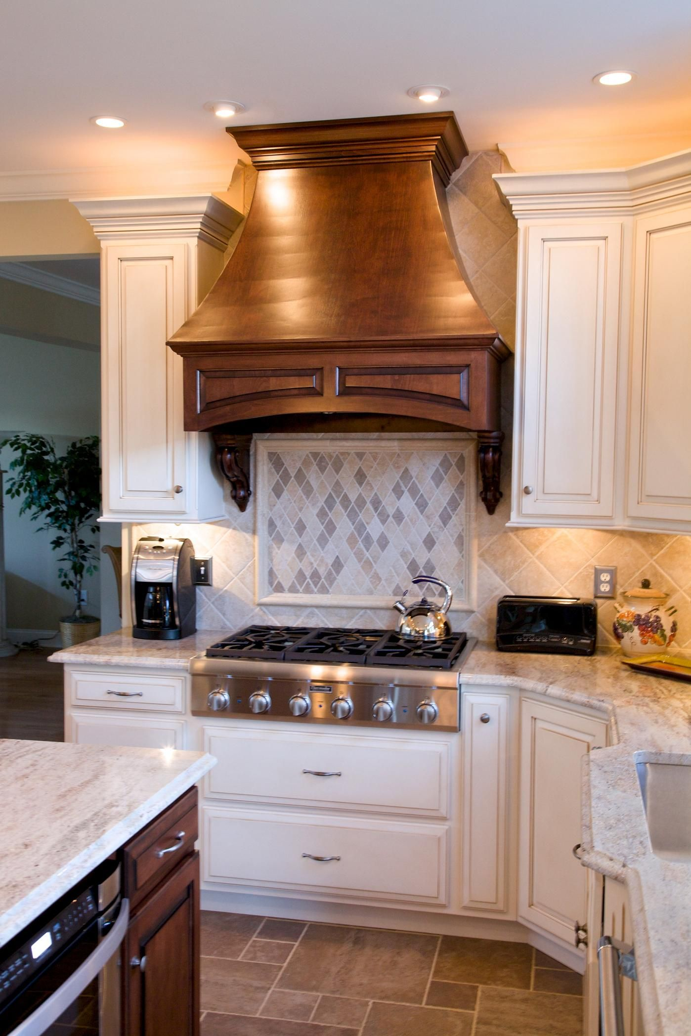 Kashmir Gold granite countertops with natural stone backsplash tile ...