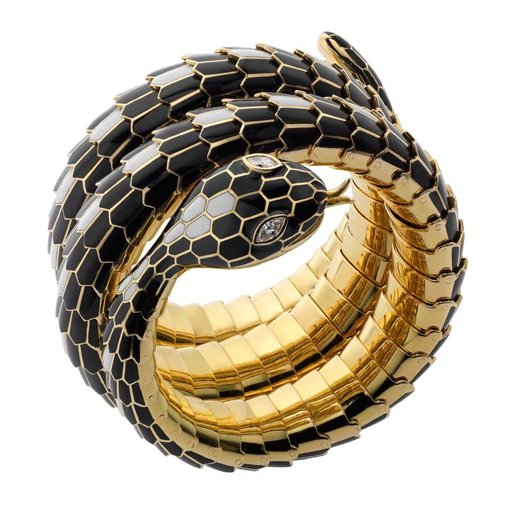 Snake bracelet in gold and polychrome enamel (B616), circa 1965. The flexible bracelet is designed as a coiled snake, the scales decorated with white and black enamel & the head with pear-shaped diamonds eyes by Bulgari