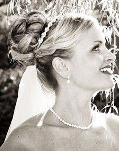 Pieced Bun Wedding Updo With Veil