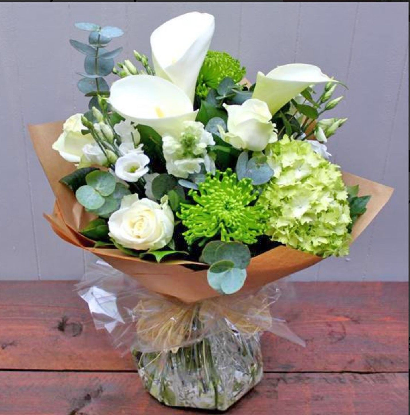Simple And Stylish This White And Green Hand Tied Bouquet Brings