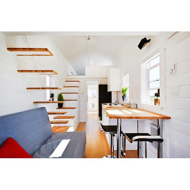 310 square foot tiny home with double loft and outside porch. Could you see yourself living here?  Temporary link in bio for more pictures! #tinyhome #tinyhousemovement #tinyliving #tinyhouse #tinyhousenation #tinylifestyle #compactliving #smallhomes #homedecor #interiordesign #outdoorliving #containerhome #fixerupper #hgtv #tinyhouses #houseboat ------------------------- 📷: tinyhousetown.net