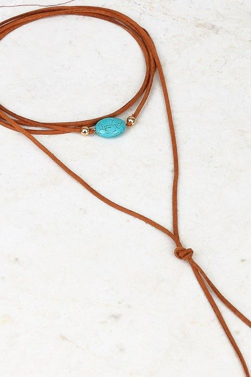 Classic suede wrap choker with turquoise stone pendant and accents.  Approx 60″ in total length.