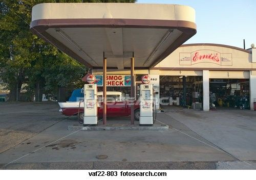 A Vintage 1957 Chevy Parked In Front Of Antique Gas Pumps At Ernie S Old Auto Garage Santa Paula Ca