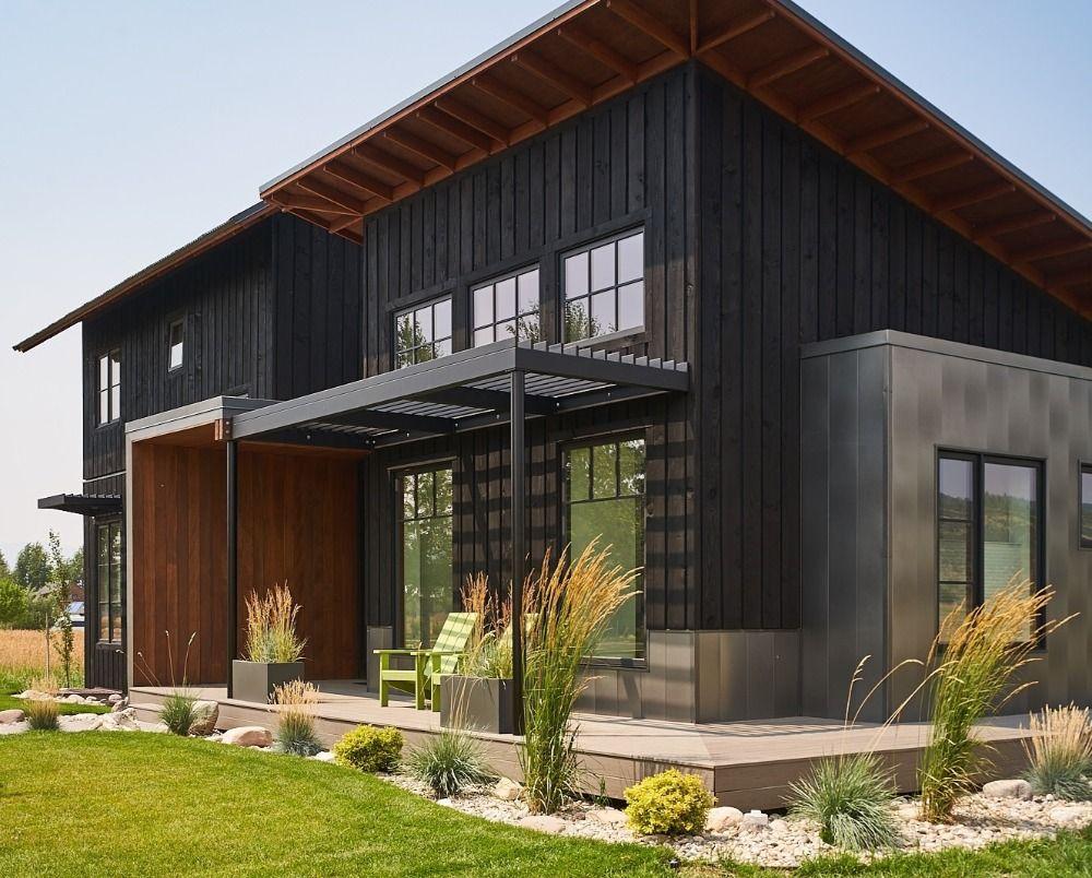 Modern Farmhouse In Aquafir Black Steel Siding Modern House Exterior Modern Farmhouse