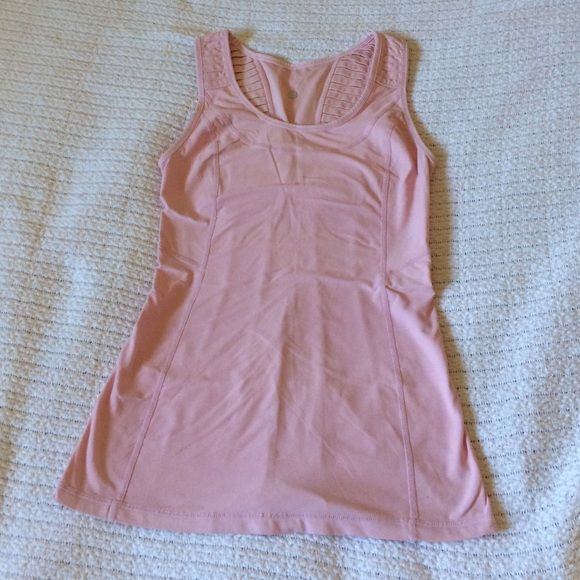 Pink Lululemon Workout Tank Very soft and cute. Comfortable work out tank worn a few times. Needs a new home. Excellent condition. Also has a mini pocket inside. Price negotiable. lululemon athletica Tops
