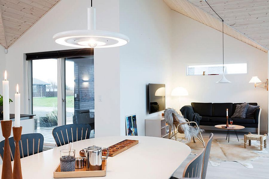Stylish pendant and sconce lights enliven the relaxing holiday home ...