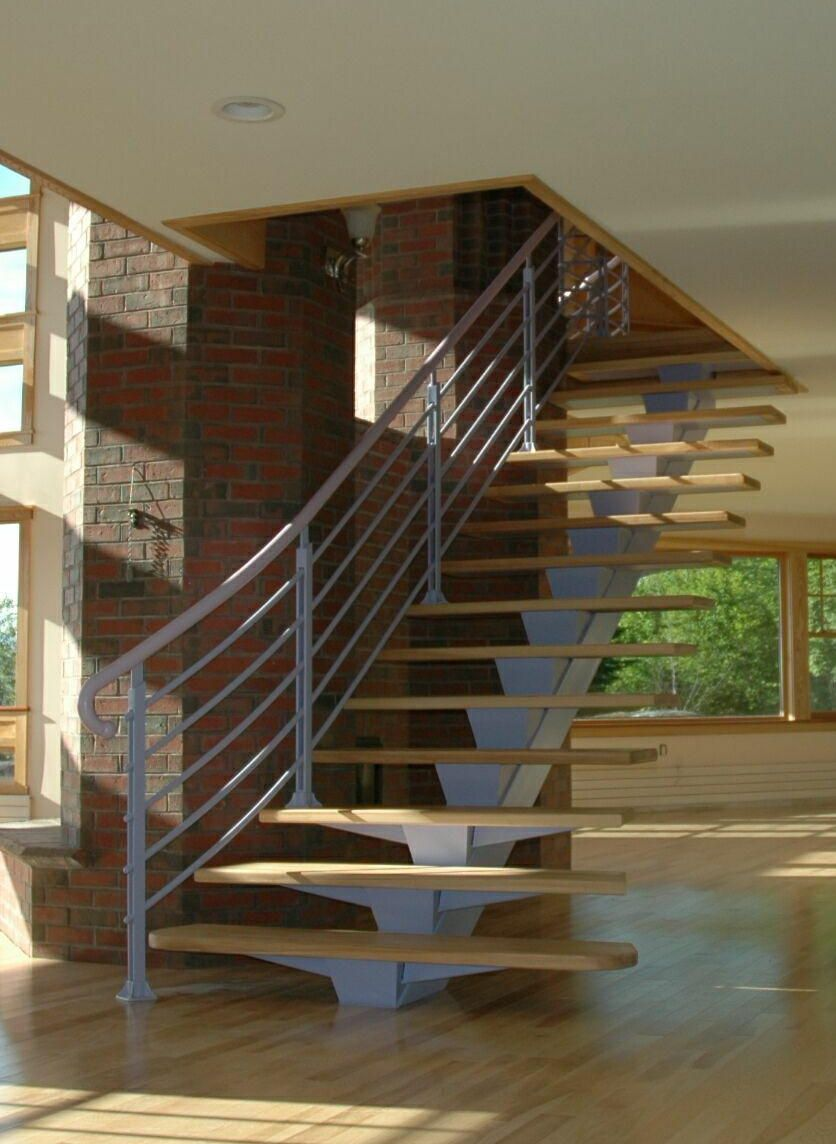 Open Riser Stair With One Central Tube Steel Stringer And Railings  Featuring Round Steel Balusters Mounted