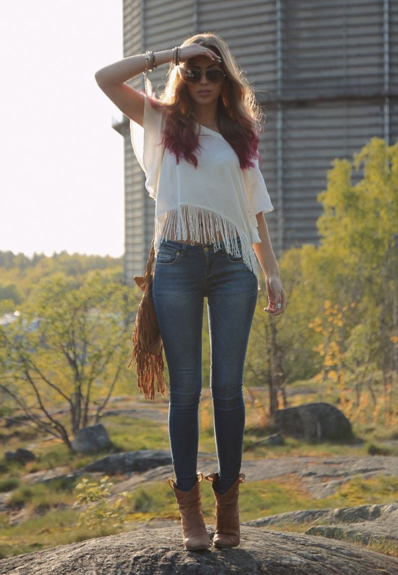 boho white shirt with fringe, skinny jeans, boots and spell designs boho leather fringe bag