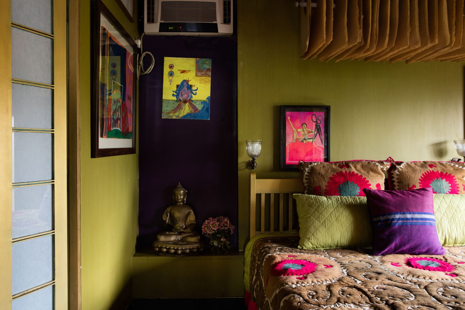 A bedroom with a handmade light fixture above the bed. Image Courtesy:Pankaj Anand