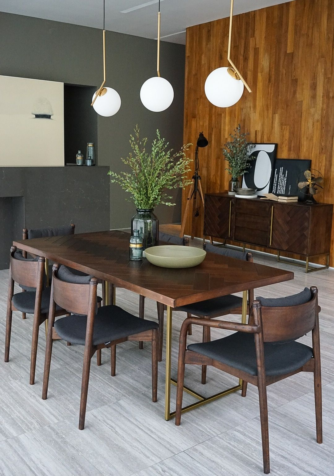 How a modern vintage home is designed featuring the brown bruno dining table with its distinctive herringbone pattern set in sturdy acacia wood