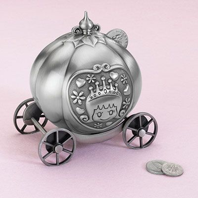 "This silver pewter coin bank is designed to look like a fairy tale pumpkin coach, with princess artwork on both sides and wheels that spin. The coin slot is located near the top. A cap at the bottom twists open when needed. Size: 4.25"" wide, 4.75"" tall."
