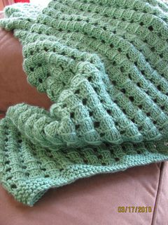 a403f97755 A simple to knit stitch pattern yields impressive results in this quick and  warm afghan.