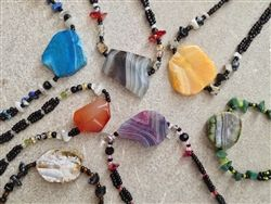 These stunning stone necklaces are very high quality and stunning.  Because of the individuality of the stones, each on is unique.  Elevita.com