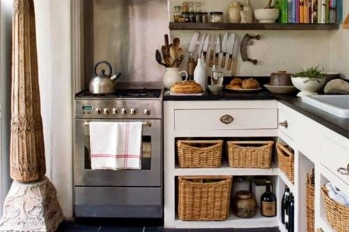 love these open cupboards and baskets. bonus magnetic knife rack!