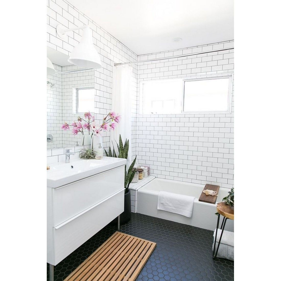 All white bathroom with black penny tiles for monochrome look ...