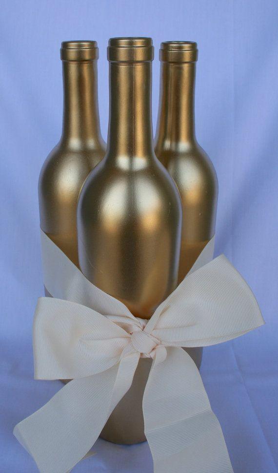 Gold wine bottle centerpiece centerpieces pinterest for Gold wine bottle centerpieces