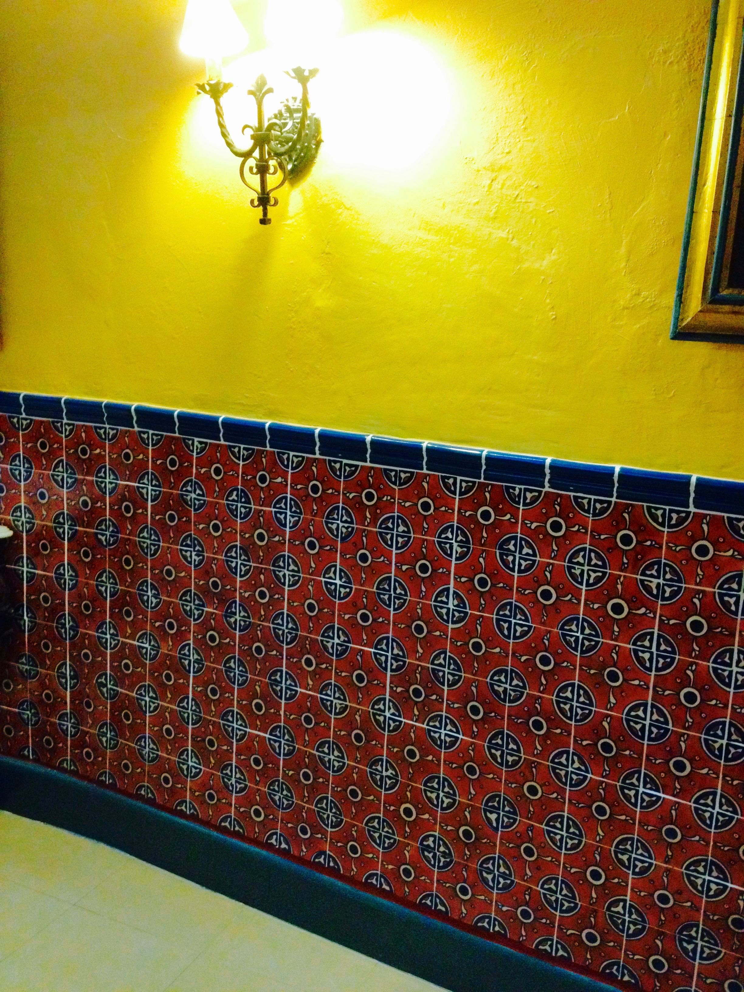 Elegant Mexican tile wainscoting can turn an ordinary hallway into ...