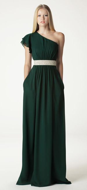 "One shoulder with flutter sleeve bridesmaid dress with built in waistband. Waistband hits slightly above the natural waist. Shown here as a full length ""J"" skirt in forest georgette. Accessorized with our beaded sash (sold separately). Fully lined, made in USA. www.ariadress.com"