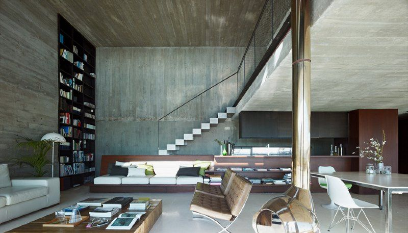 Exposed Concrete Provides A Perfect Unobtrusive Backdrop To An Eclectic Mix  Of Furniture And Fittings.