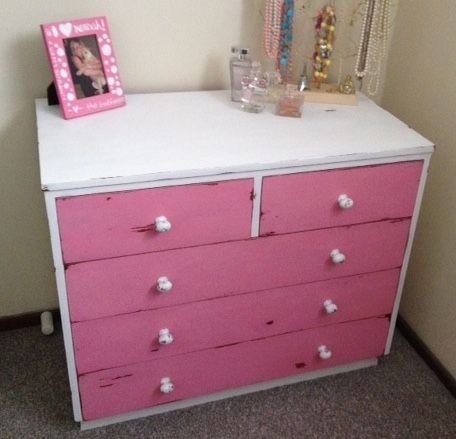 Beautiful refurbished solid wood dresser done in own brand chalk paint with cute white painted brass knobs and matching pink mirror.