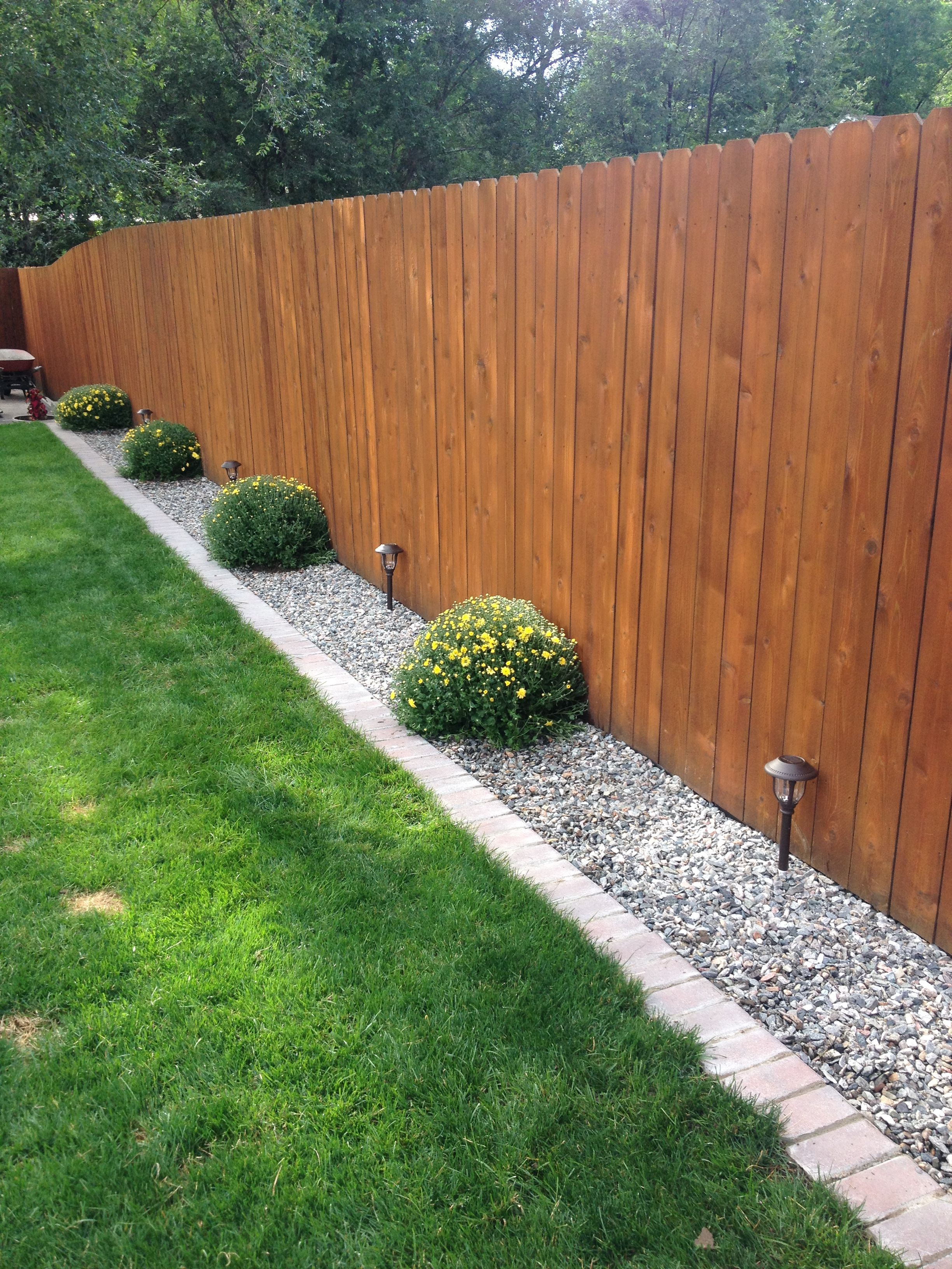 Brick And Gravel Lawn Border Easier To Mow Keep The Dogs From Digging Under Fence Backyard Landscaping Designs Garden Landscaping Diy Backyard Landscaping