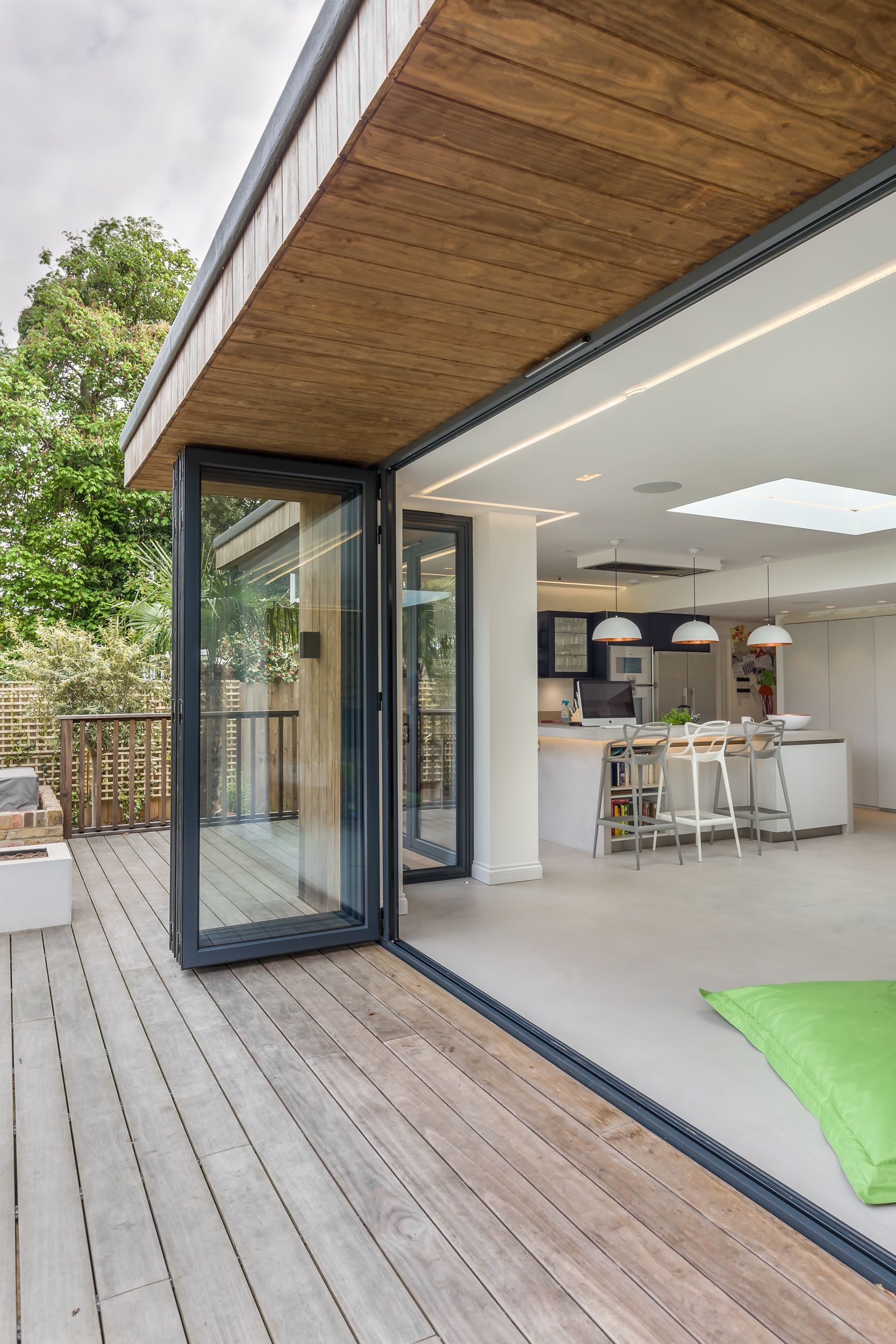 Bi Fold Doors Inside Outside Level Threshold Timber Decking Timber Clad Roof Overhang Open Plan Contempo Flat Roof Design House Exterior House Roof