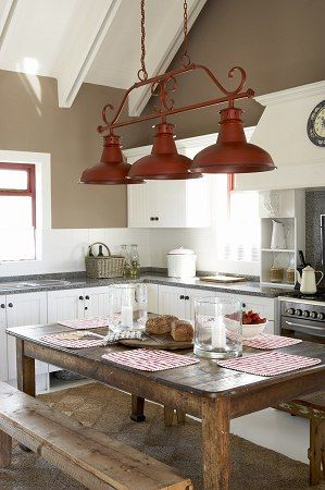 love the wood table right in the kitchen and the splashes of red