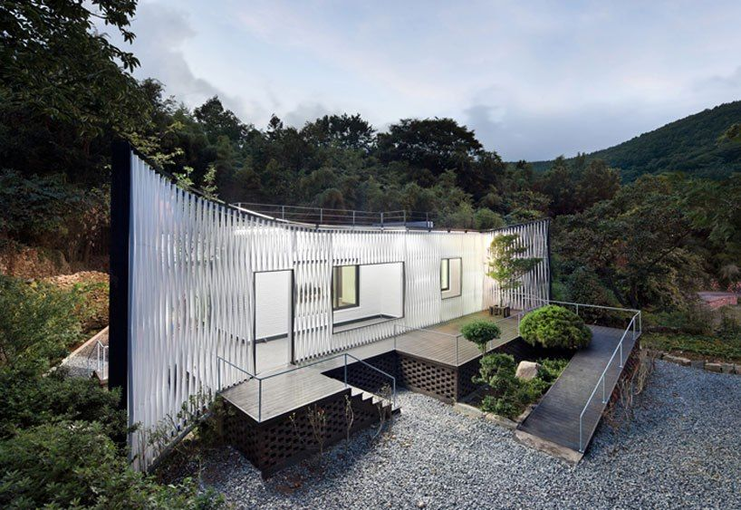joho architecture / jeong hoon lee: namhae house    in a rural community filled with poorly copied Western-style houses, the home dares to be different, inventing a unique identity as it returns to its forest surroundings.    see more: http://www.designboom.com/architecture/joho-architecture-jeong-hoon-lee-namhae-house-renovation/ (818×563)