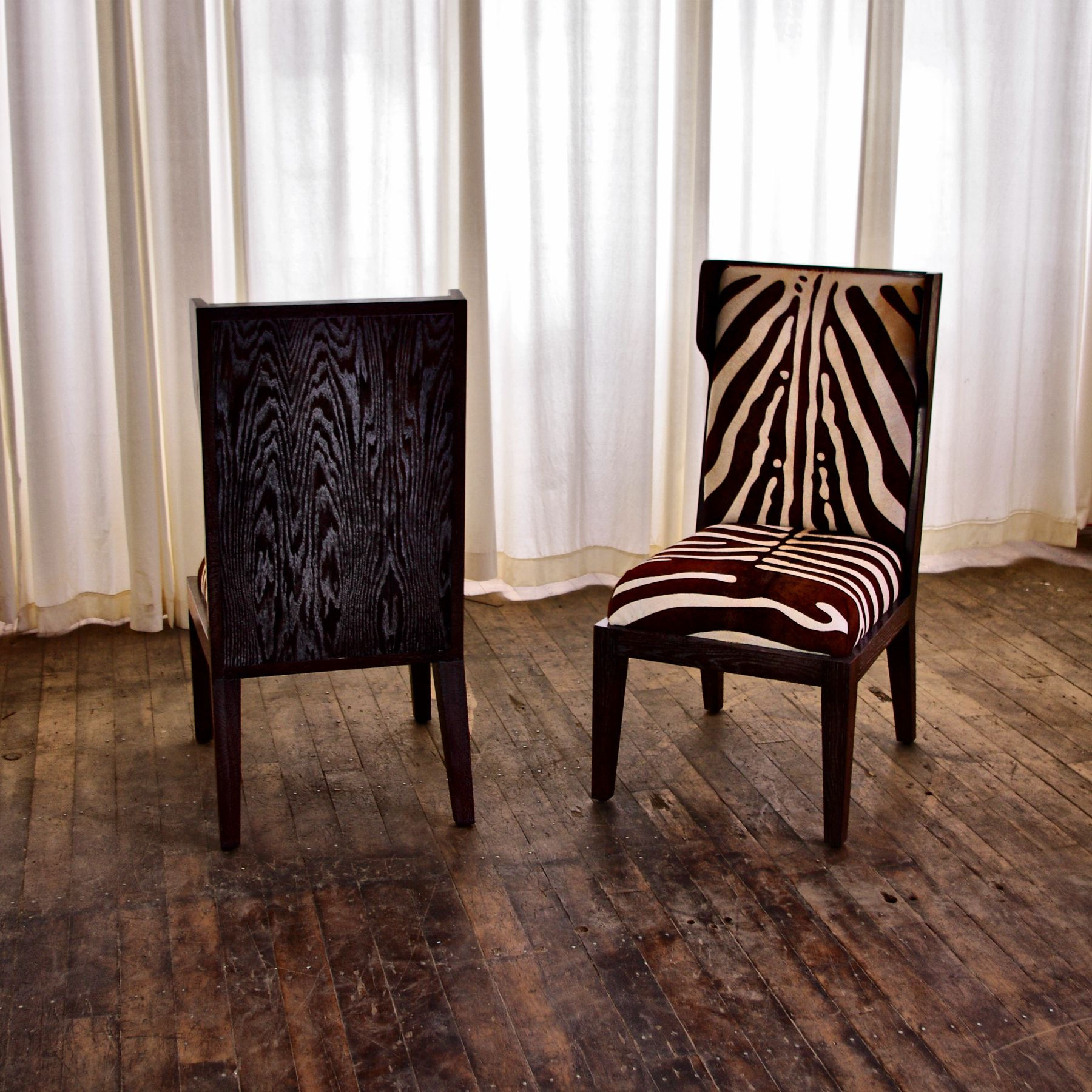 Dining chair no sixty four featured in brown zebra hide ad home
