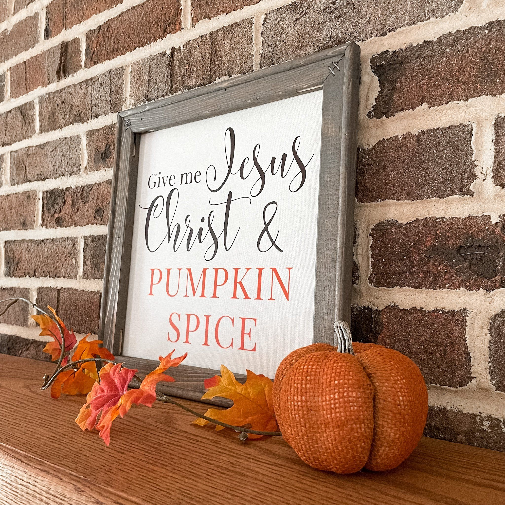 """Give me Jesus Christ & Pumpkin Spice These unique reverse canvas signs are hand pressed with high quality heat transfer vinyl onto canvas. The frames are hand stained with a premium wood stain. Hanging hardware is included. Sign measures 14""""h x 14""""w We love custom orders! Contact us to get started!"""