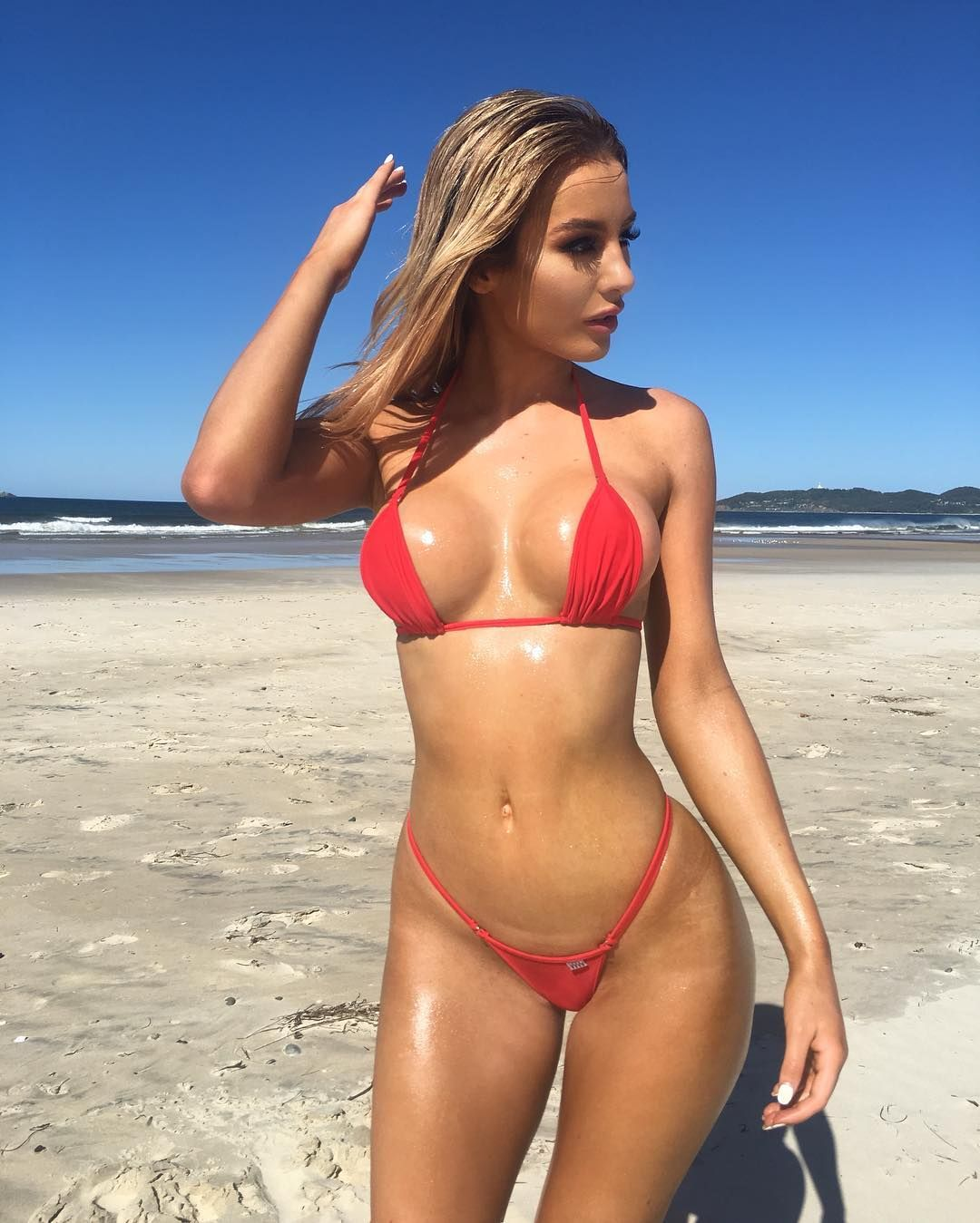 Blonde bombshell Lucie Jaid in a tiny red bikini