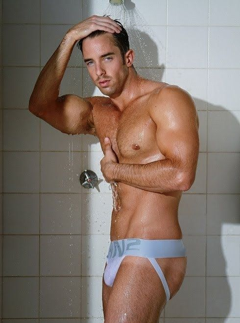 Muscle jock taking a shower