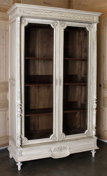 Repurpose an armoire for your product display. Cut open doors, put ...
