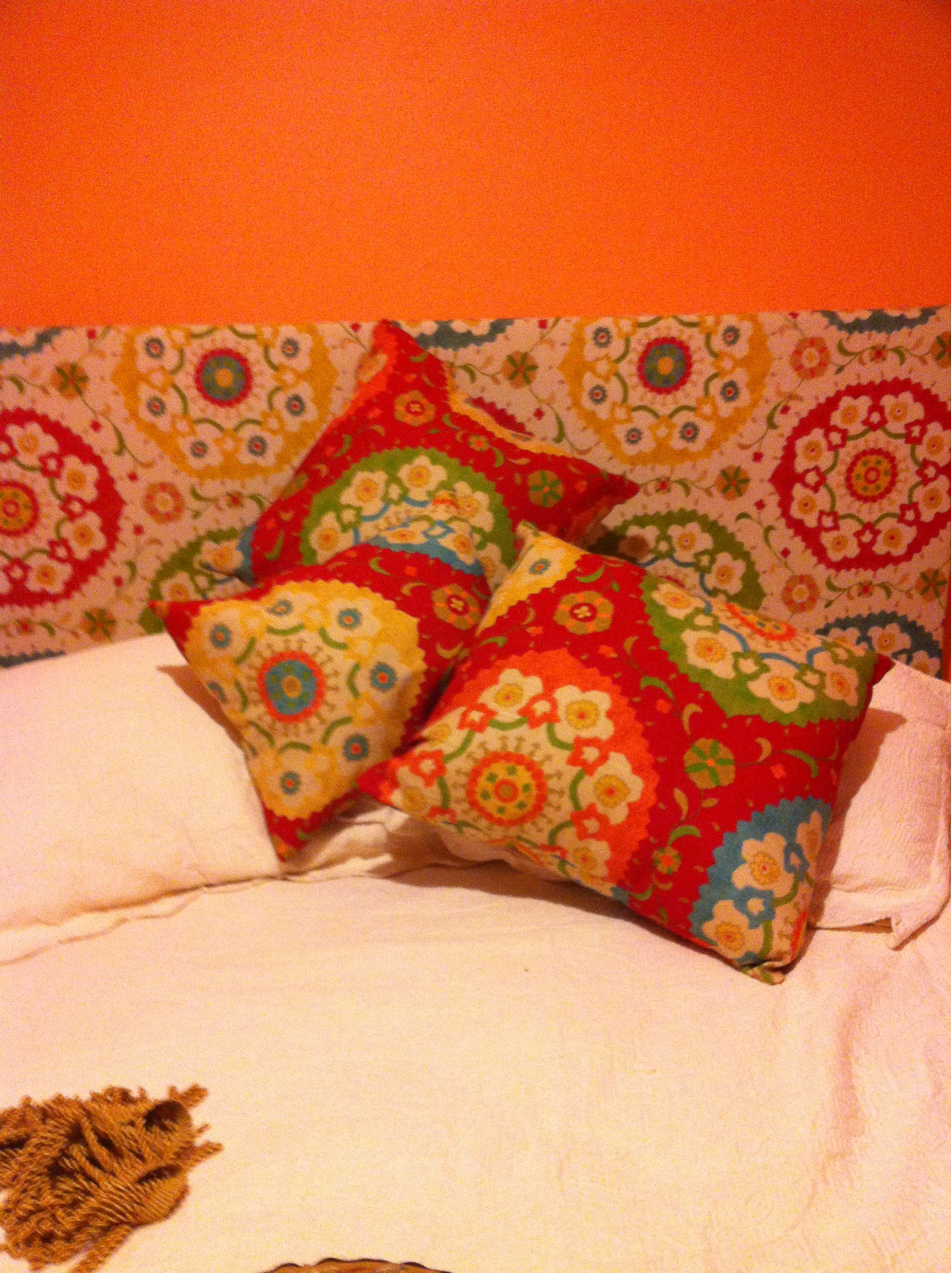 I made the headboard using another pin for instructions. Thanks to mom for sewing the pillows. (I did stuff them and glue them :)