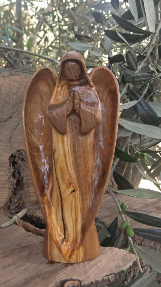 Angel hand carved olive wood sculptureby eric kempson