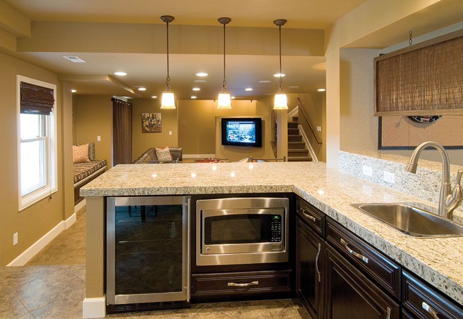 The Basement Wet Bar Features Plenty Of Storage While Under Counter  Appliances Provide Clutter Free Counters