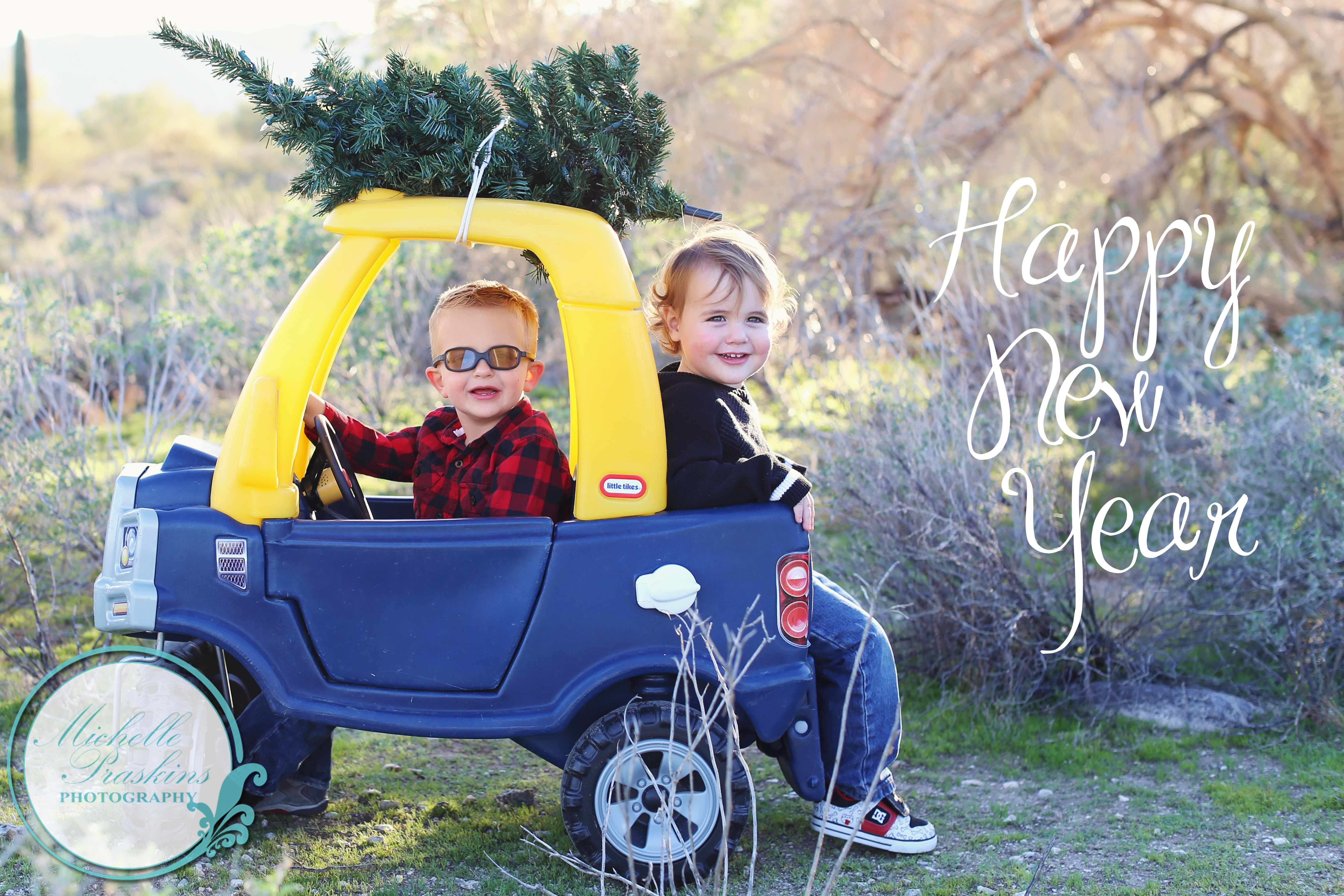 merry christmas and happy new year christmas photo idea with little tikes car and christmas tree michelle praskins photography