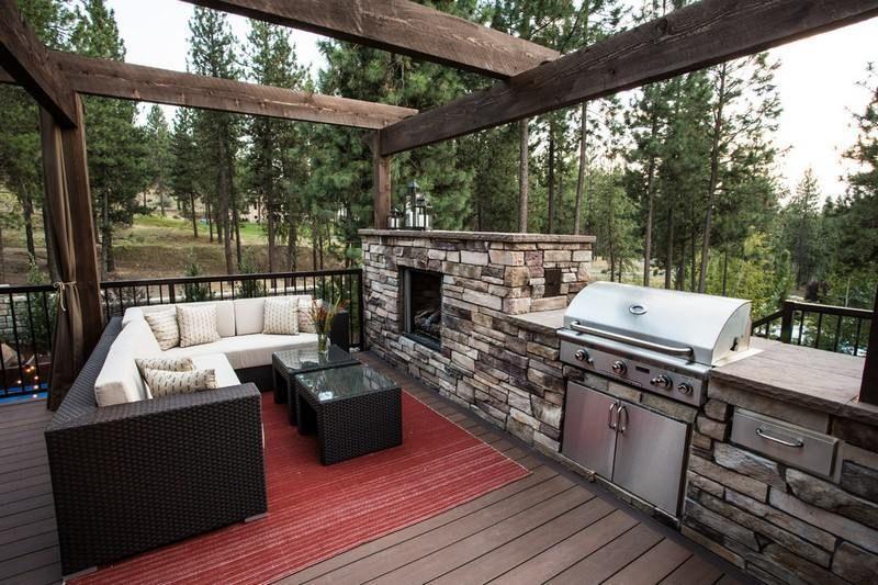 barbecue cuisine d'été à gaz avec couvercle et cheminée en pierre naturelle