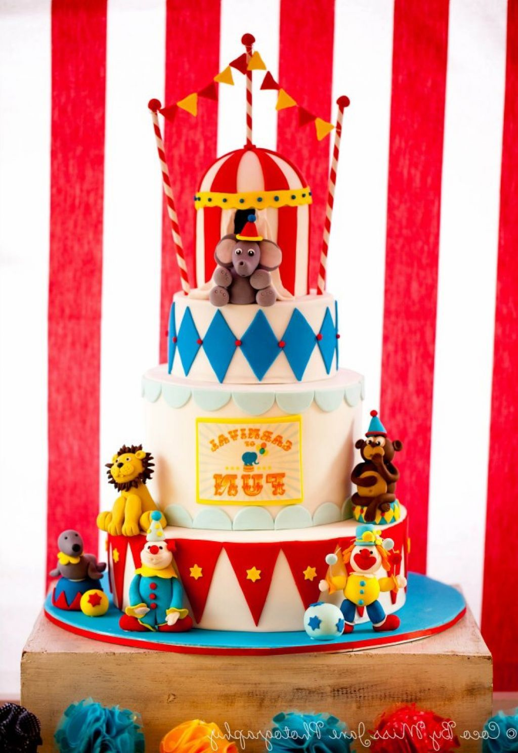 Tired Circus Themed Cake Featuring Handmade Circus Animals Clowns