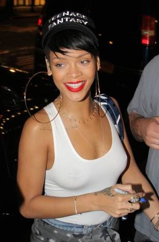 rihanna steps out in huge earrings, visible nipple rings — crazy or